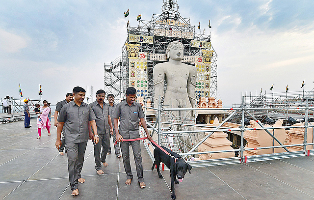 Security personnel along with their sniffer dogs inspect the area around the 57-foot-high monolithic Gomateshwara statue on Vindyagiri in Shravanabelagola, around 160 km west of Bengaluru on Wednesday. Thousands of Jain devotees will attend the Mahamastakabhisheka (head anointing ceremony) on  February 17. PTI Photo by Shailendra Bhojak
