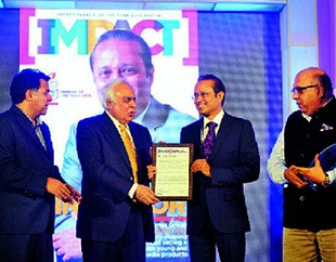Times Group MD Vineet Jain receives 'Impact Person of the Year' award from Union law and communications minister Kapil Sibal. They are flanked by exchange4media chairman Anurag Batra (R) and Colors CEO Raj Nayak