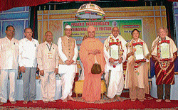 Recognition: Dr Rajaram Jain, Dr Nalini Balabeer, Prof Adelheid Mette were awarded the Prakrit Jnanabharathi International award for the year 2007, 2008 and 2009 respectively. Prof Pre Suman Jain, M J Indrakumar, Nadoja Hampa Nagarajaiah, Ajith Kabbina and Sri Charukeerthi Bhattaraka Swamiji are seen.  DH photo